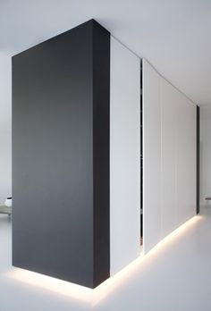 Closets with plinth lighting inside the Penthouse II in Copenhagen by Norm | http://apartment-design-707.blogspot.com