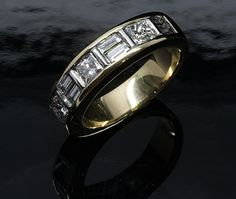 Custom made 18ct. Yellow gold Princess cut and Baguette diamond ring. All handmade and handset.