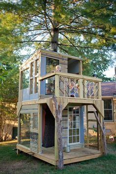 OMG I want to build a playhouse using recycled materials, old windows, extra siding, old decking, I would love to build this for our grand children's secret garden under our giant old willow trees!  AND we could make space to harvest our apple tree!  Tea party anyone? ♥