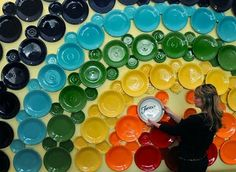 Rainbow Plate Wall Display, very nifty, I don't care if people think it's old fashioned I love decorating with plates