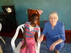 Rose pictured with the Rev Gwyneth Owen is a girl, aged 13,  who is a single orphan and is mentally and physically handicapped. Rose also suffers from epilepsy. Rose has experienced a very tough and challenging life, she started epilepsy as a baby and at age 3 fell into a cooking fire & suffered severe burns to her face, arms and legs, leaving her with severe scarring and contractures of both arms, limiting useful movement. Sadly it also reduced Rose's walking ability. Rose Pictures, The Rev, Epilepsy, Age 3, Orphan, Charity, Arms, Walking