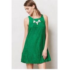 Anthropologie Kelly Green Lace Dress Beautiful jelly green dress! Lovely lace detailing and cut out back with bow. Also looks great belted. In excellent condition but for one small imperceptible pull in the fabric (see second pic). Worn once to my law school's Barrister's Ball. Brand is Leofsdottir. Anthropologie Dresses Mini
