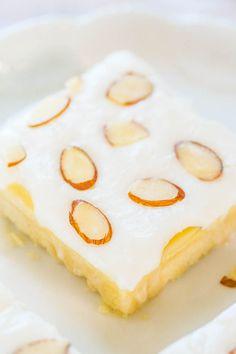 Almond Cream Cheese Shortbread Bars - Easy, buttery shortbread is topped with cream cheese..mmm! Plus irresistible almond frosting!! A wonderful springtime dessert!