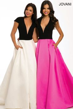 Cap sleeve floor length ballgown with a sheer plunging v-neckline and open back features an A-line poly-satin skirt