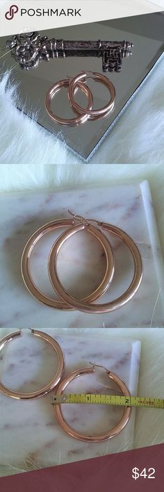 """Bronzo Italia rose colored earrings Highly polished rose colored 2"""" hooped earrings from the Bronzo Italia Collection. Nickel free and tarnish resistant with snap bar closure. Updated classic hoops with the gorgeous rose color. Never worn EUC! Bronzo Italia Jewelry Earrings"""