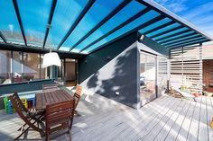 roof terrace modern designed wooden floor plexiglas a canopy