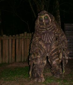 "Shambling Mound. (Because of the ""tendrils"" around the eyes this looks a bit like the comics character ""Man-Thing"". Costume looks great.)"