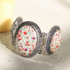wild latana flower pendant bracelet  $15.99  Beautiful yellow and red blossoms adorn this intricate silver hued linked bracelet