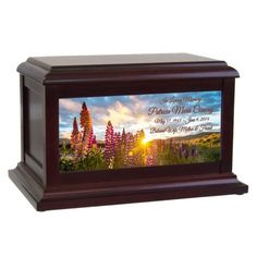 The Wild Flowers Cremation Urn is one of the urns from the Keep The Memory™ Urn Series, exclusive to In The Light Urns. This colorful field of wild flowers and the beautiful set sun is a glorious picture of earth's wonderful nature. Each urn is made of birch wood with a quality rose wood finish. #cremation #urn