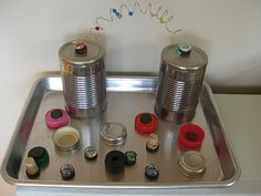 Abstract / Pretend Play Invitation to Play: Tin Can Robots - have been meaning to try this one for some time now!  Empty clean cans and then various items with magnets.