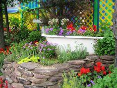 Bathtub Flowers Bathtub full of flowers. Outdoor Flowers, Beautiful Gardens, Garden Statues, Garden Decor, Garden Tub, Farm Gardens, Garden Structures, Garden Bathtub, Landscaping With Rocks