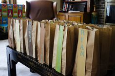 Goody bag: Stenciled kids names onto colored paper and glued to a brown lunch bag