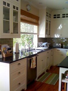 Kitchen | White cabinets, Black countertops and Countertop