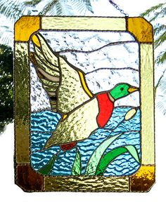 """Canada Goose Suncatcher - Handcrafted in Stained Glass - 9 1/2"""" x 12"""" - $54.95  - Handcrafted Stained Glass Designs  - Handcrafted Stained Glass Designs  - Glass Suncatchers, Stained Glass Décor, Stained Glass Sun Catchers -  Stained Glass Design   * More at www.AccentOnGlass.com"""