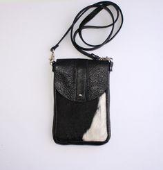DAKOTA Cow Hide Crossbody Bag - Black and White Hair on Hide - Black Leather - Leather Messenger Bag - Boho - Womens Handmade Handbags by margeandrudy on Etsy https://www.etsy.com/listing/221991570/dakota-cow-hide-crossbody-bag-black-and