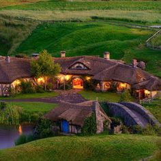 Real life Hobbit pub opens in New Zealand. The Green Dragon Pub at Hobbiton, near Matamata in the North Island of New Zealand, was originally built as part of the set for The Hobbit but was opened to the public as a licensed pub in late November. Dragon Vert, Green Dragon, Places Around The World, Oh The Places You'll Go, Around The Worlds, Casa Dos Hobbits, Beautiful World, Beautiful Places, Stunningly Beautiful