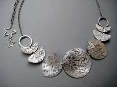 Many Moons Moon Phase Necklace Hammered Metal Moon by AuroraShadow