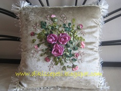 pillow with pink ribbon embroidery rose