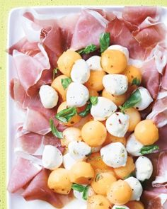 Bring a little bit of la dolce vita to your dining room with these savory snacks inspired by our favorite Italian and Italian-American restaurants. Cantaloupe and Mozzarella with Prosciutto and BasilPink, white, and orange paint a pretty picture on this antipasti platter.