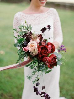 Crimson, mahogany and peach wedding bouquet: Photography : Anna Tereshina Photography Read More on SMP: http://www.stylemepretty.com/destination-weddings/2016/08/31/chic-modern-swiss-countryside-chateau-wedding/