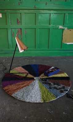Coachella rug - Plümo Ltd  Knitted wheel rug in muted autumnal colours. Rug backed in hessian. Fairtrade. Dia.100cm.