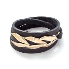 Leather joins brass in Collette Ishiyama's Laurel Wrap Bracelet. Black leather strap with polished, recycled brass embellishment wraps twice around the wrist for a luxe punk look.