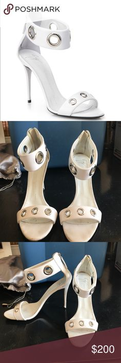 Giuseppe Zanotti white leather grommet heels 100% authentic Giuseppe Zanotti heels. Not in the best shape because I wore them to a bbq and the cobblestone ripped up the heels a bit Bought at Saks. Priced to sell! Giuseppe Zanotti Shoes Sandals