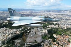 Hellenic Airforce Mirage 2000 flying over the Acropolis in Greece