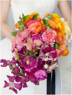 Celebrating color... bouquet by Sinclaire and Moore |  photo by Belathee