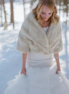 a warm wrap paired with a lace gown by http://www.phillipsbridal.com/  Photography by Laura Murray Photography, http / lauramurrayphotography.com/