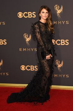 Keri Russell wore a J. Mendel Resort 2018 black eyelash lace embroidered ostrich feather gown to the Primetime Emmy Awards. She accessorized with Nikos Koulis jewelry Ellie Saab, Celebrity Red Carpet, Celebrity Look, Tom Ford, Marc Jacobs, Feather Fashion, Keri Russell, Red Carpet Gowns, Feather Dress