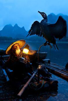 China. Fisherman with cormorant