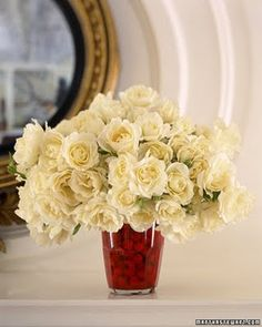 White Roses: use a red vase or goblet as well