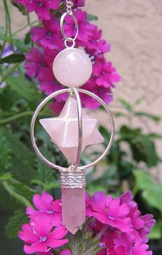 Rose Quartz is the stone of universal love.  Rose Quartz Merkaba Crystal Healing Pendulum $18
