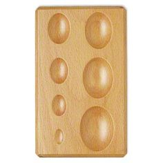 Dapping block, wood, 1/2 to 1-3/4 inches, 6-1/4 x 4 inches overall. Sold individually.