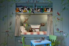 built ins for storage and cute stuffed animal storage over cubby bed w/ curtains.
