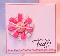 Love the flower bow on it, thinkin i like this but want a lily flower and cheetah print card..just an idea maybe!!:D