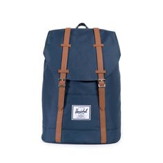 NAVY/TAN SYNTHETIC LEATHER RETREAT BACKPACK $69.99