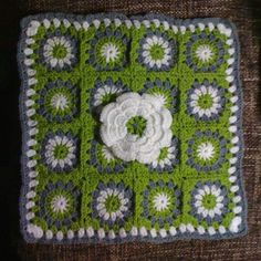 Little Squares within a Square & a Flower to boot...I LOVE this square!