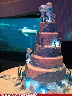 I once imagined having a reception at an aquarium. This definitely would have been the cake. Beautiful.