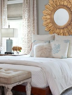 love the coral pillows, white textured bedding, blue accent lamp, long curtains and seat at end of bed. DONE