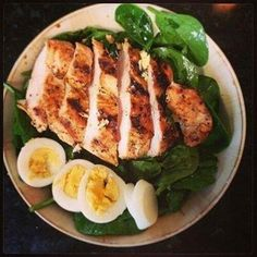 Marinated roster chicken served over spinach with a citrus vinaigrette.