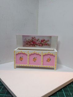 painting, adding flower decals and printed flowers and there you have a nice little treasure chest