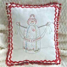 """Crazy Quilt Snowman Pillow: This darling pillow from Crabapple Hill was designed by Meg Hawkey. Here is what she says about her design, """"This embellished snowman will help you welcome winter with one of four different sayings (or add your own!) Embroidery, beads & rickrack........so Happy!!! Pillow is 13"""" x 15""""."""""""