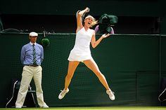 Maria Sharapova flies off the ground after hitting a forehand