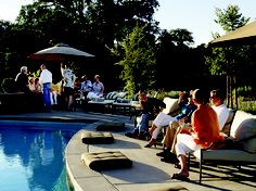 "Students lounging poolside after a day of class at ""The Art of Wood-Fired Cooking"" school in Healdsburg, CA."