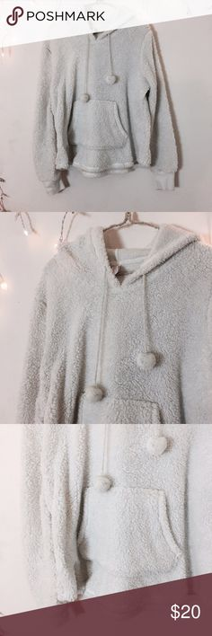 White Fluffy Hoodie Super soft and extremely comfortable! Great for lounging with sweatpants. Tag size large but best fits a small or medium for a oversized cute fit. Not Brandy Brandy Melville Tops Sweatshirts & Hoodies