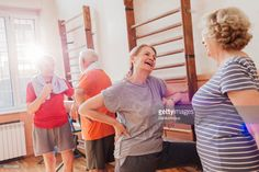 active seniors talking and having fun after finished exercising