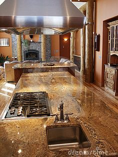 Kitchen area with stainless appliances,plumbing fixtures and granite counter tops.