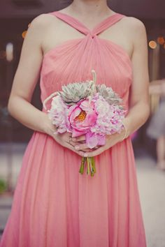 Lovely pink bouquet with succulents by Bows + Arrows. Photo by Nbarrett Photography. #wedding #bouquet #pink #succulent